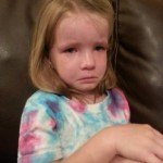 Upset because she is worried her boyfriend won't come to her princess party