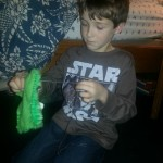 Logan learns to sew and makes a sock-monster